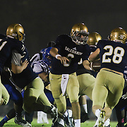 Salesianum quarter back Garrett Cannon (6) hands off the ball to Salesianum Running Back Colby Reeder (28) in the second quarter Friday, Oct. 09, 2015 at Bernard Stadium in Wilmington, DE.