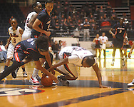 "Arizona's Davellyn White (0) and Ole Miss' Latosha Laws (23) go for the ball at the C.M. ""Tad"" Smith Coliseum in Oxford, Miss. on Thursday, November 18, 2010. Arizona won 72-70."