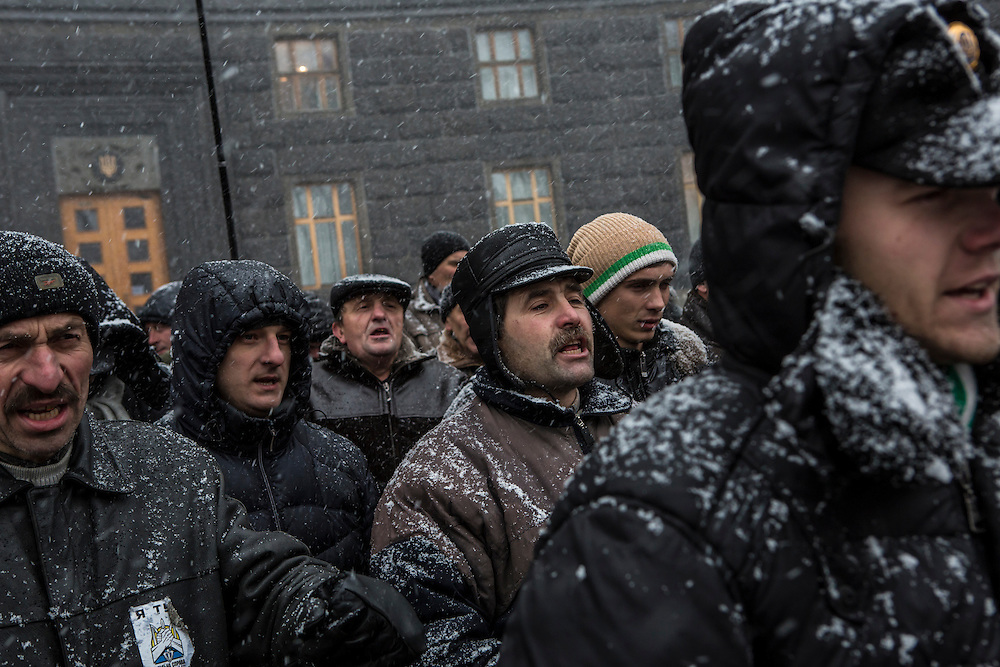 KIEV, UKRAINE - DECEMBER 6: Anti-government protesters rally outside the Cabinet of Ministers on December 6, 2013 in Kiev, Ukraine. Thousands of people have been protesting against the government since a decision by Ukrainian president Viktor Yanukovych to suspend a trade and partnership agreement with the European Union in favor of incentives from Russia. (Photo by Brendan Hoffman/Getty Images) *** Local Caption ***