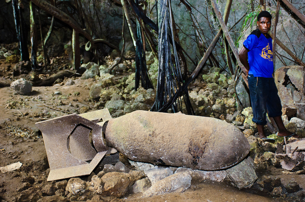 An unexploded bomb inside the 'Japanese Cave', Biak, West Papua, Indonesia. In World War II, a strategic airfield of the Imperial Japanese Army was located on Biak, serving as a base for operations in the Pacific theatre. American forces eventually captured the island during the Battle of Biak in 1944.