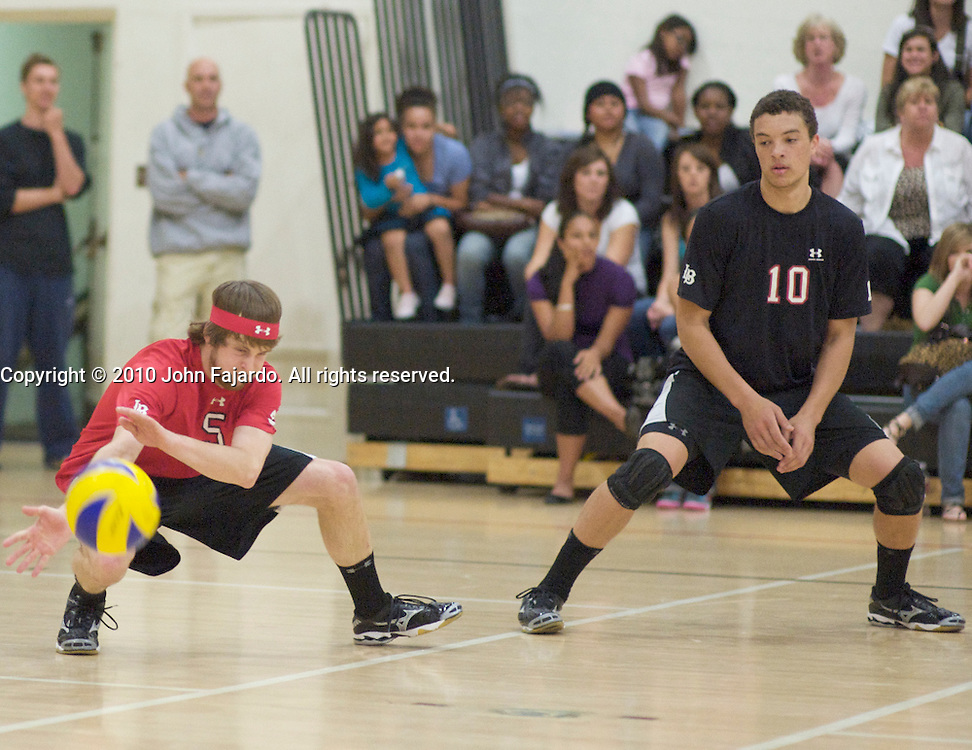 The kill shot drops in front of Troy Crutchfield(5) as Rob McLean(10) watches in the Western State Conference match against Moorpark College at the LAC Small Gymnasium, Friday, March 26, 2010.
