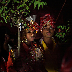 Giniaj Mehra, left, a young groom, is escorted to his marriage ceremony in Rajasthan, India on April 27, 2009.