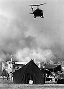 rp020580b/ASEC/Richard Pipes -- A National Guard helicopter flies over a burning New Mexico Penitentary near Santa Fe during the riot in 1980.