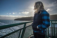 Young woman on the Washington State Ferry in route to Orcas Island.