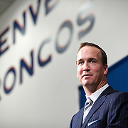 SHOT 3/20/12 1:45:30 PM - The Denver Broncos introduced free agent quarterback Peyton Manning at team headquarters in Englewood, Co. at a press conference on Tuesday Marc 20, 2012. Manning is coming off neck surgery and was released by the Indianapolis Colts. He signed a five year, $96 million contract with the Broncos..(Photo by Marc Piscotty / © 2012)