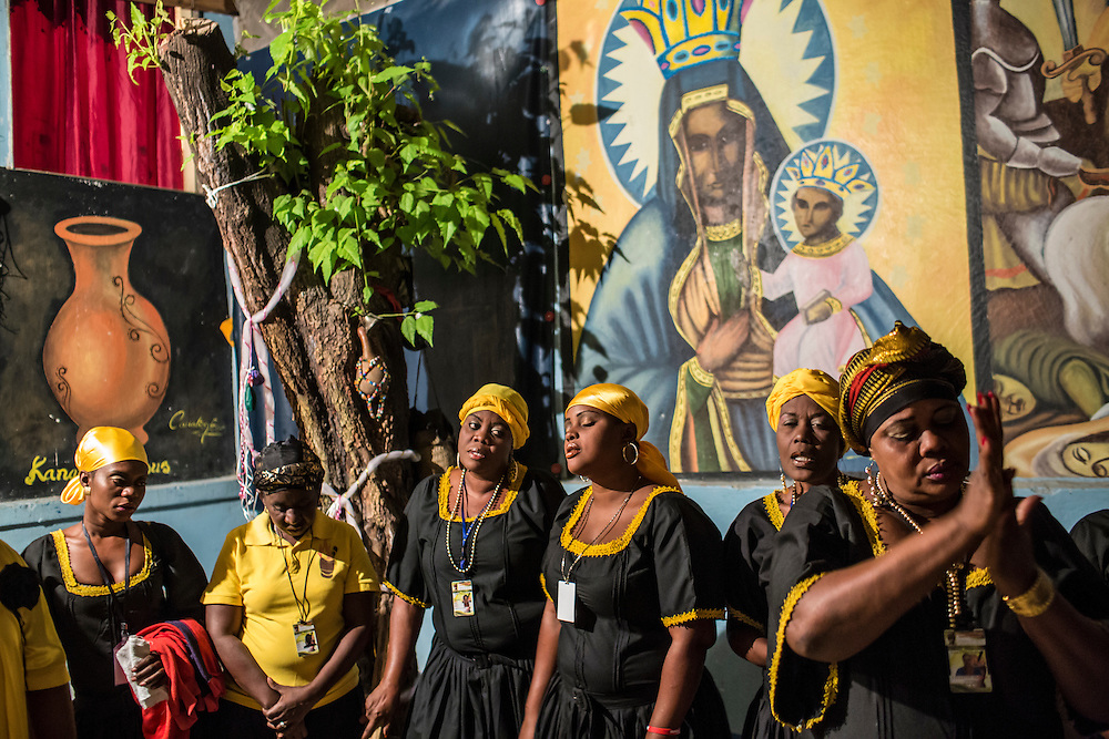 Members of the Societe Ti Pilon Baka vodou troupe prepare for a ceremony on Sunday, December 14, 2014 in Port-au-Prince, Haiti.
