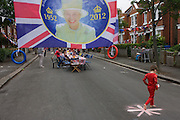 A community street party in Dulwich, south London celebrating the Diamond Jubilee of Queen Elizabeth. A few months before the Olympics come to London, a multi-cultural UK is gearing up for a weekend and summer of pomp and patriotic fervour as their monarch celebrates 60 years on the throne and across Britain, flags and Union Jack bunting adorn towns and villages.