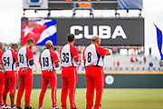 SAN JUAN, PUERTO RICO FEBRUARY 8: Players of Cuba line up for the anthem during open ceremonies for the final championship game against Mexico on February 8, 2015 in San Juan, Puerto Rico at Hiram Bithorn Stadium(Photo by Jean Fruth)