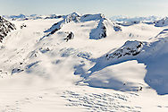 Deep snow layers over the underlying icecap and glaciers of the Chugach Mountains in Chugach State Park near Anchorage in Southcentral Alaska. Spring. Morning.