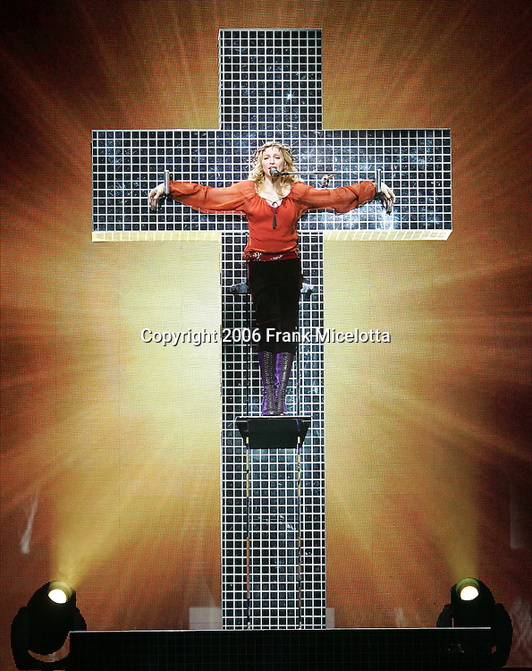 "LOS ANGELES - MAY 21: Singer Madonna performs on the opening night of her ""Confessions"" tour at the Great Western Forum on May 21, 2006 in Los Angeles, California. (Photo by Frank Micelotta/Getty Images)"
