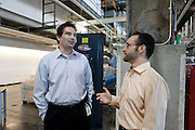 """Jonathon """"J"""" Stone (right), Fellow with the Environmental Defense Fund and Paul Jakubski (left) of News Corp. Jonathon Stone of the Environmental Defense Fund consulting for the NewsCorp printing plant in Bronx, New York."""