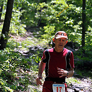 Dan Brendan, 57, from Phoenix, AZ, makes his way down a rocky section of the trail during the  Massanutten Mountain Trails 100 Mile run (MMT 100) May 17, 2008..Brendan finished 34th overall with a time of 30:17:39. Brendan has a tradition of carrying his wife over the finish line in every Ultra Marathon he finishes.  ..The  MMT 100 is considered one of the toughest Ultra Marathons on the east coast. The  Massanutten Mountain Trails 100 Mile run (MMT 100) May 17, 2008.<br /> The  race is considered one of the toughest Ultra Marathons on the east coast.