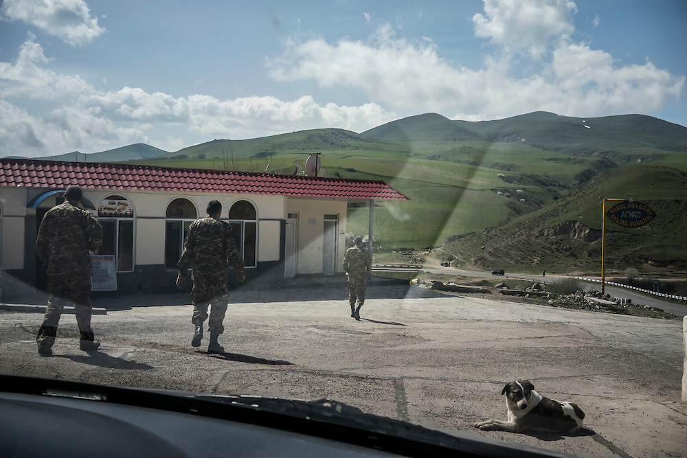KARASHEN, ARMENIA - APRIL 17:  Soldiers at a filling station on February 21, 2015 in Karashen, Armenia. Since signing a ceasefire in a war with Azerbaijan in 1994, nearby Nagorno-Karabakh has functioned as a de facto part of Armenia, with hostilities along the line of contact between Nagorno-Karabakh and Azerbaijan occasionally flaring up and causing casualties. (Photo by Brendan Hoffman/Getty Images) *** Local Caption ***