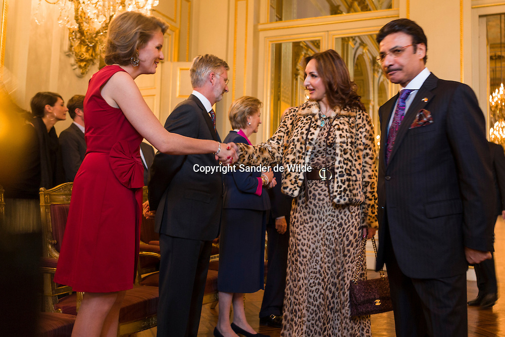 Belgian's Princess Mathilde (left) greets Saudi Ambassador to Belgium Faisal Bin Hassan bin Ahmed Trad (right) and his wife (2nd from right)  on January 11, 2012 at a New Year reception organized by the royal family at the Brussels Royal Palace for heads of diplomatic missions in Belgium.