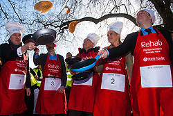 London, February 17th 2015. Members of Parliament put their dignity aside for a bit of fun as they compete in the annual Parliamentary Pancake Race in Victoria Tower Gardens adjacent to the House of Lords.  PICTURED: The media team practice tossing their pancakes. left to right, Robbie Gibb of Sunday Politics, the Sunday People's Political Editor Nigel Nelson, Nigel Nelson, Sky News Political Correspondent Sophie Ridge, and BBC Political Correspondent Ben Wright.