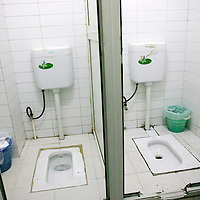 BEIJING, JULY-21-2010 : COMMUNITY TOILET OF PEOPLE LIVING IN THE BASEMENT OF A HIGH RISE.