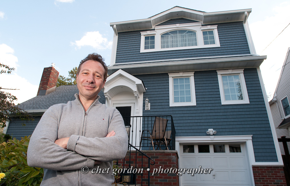 Craig Furer outside his Cranford, NJ home on Sunday, October 23, 2016. Furer and his wife Jen hired Magnolia Home Remodeling Group to complete a full exterior makeover. The company replaced the siding with shake and clapboard, added various architectural accents, replaced the roof, modified the roofline, built a front portico and replaced two windows. Craig spent a lot of time researching this project before it began and is thrilled with the overall result.  © Chet Gordon for Angie's List