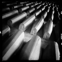 ".Every year the 11th of July a sea of coffins lined up for the funeral in the small, used to be forgotten at-the-end-of-the-road town called Srebrenica in eastern Bosnia..The international criminal court said the most terrible crimes of genocide on European soil since the Second World War were committed in Srebrenica area when the Bosnian Serb forces massacred more than 8000 of Muslims after the enclave, ironically under U.N. protection as a safe heaven, was overrun by an army led by its ruthless commander; General Ratko Mladic..On may 2011, after more than 15 years on the run Mladic was captured in a small village in Serbia and he joins Radovan Karadzic, his war-time president and another ""butcher of Balkans"", in the Hague..Over 4.000 body bags are still in a cold store, waiting to be opened and checked by the experts of ICMP (International Commission of Missing Persons), whose mission is to complete the bodies and identify them.."