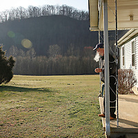 Kelly Roark stood on his porch for a smoke in the early morning in Wild Cat, Ky., on 3/19/10. Photos by David Stephenson