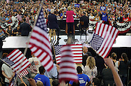 Democratic presidential nominee Hillary Clinton speaks with her husband Bill (L) and running mate Tim Kaine (R) at a campaign kickoff rally after the Democratic National Convention in Philadelphia July 29, 2016. REUTERS/Rick Wilking