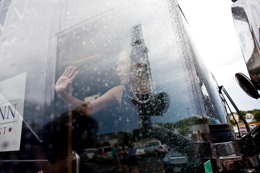 Republican presidential hopeful Michele Bachmann waves from her bus after a campaign stop at New Life church on Sunday, July 24, 2011 in Marion, IA.