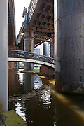 A railway, foot and road bridges over a canal in Manchester, England