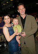 Director Alan Taylor with wife Nicki and baby daughter Ginger arriving at &quot;The Emperor's New Clothes&quot; premiere at the French Institute/Alliance Francaise in New York City. June 10, 2002. <br /> Photo: Evan Agostini/PictureGroup
