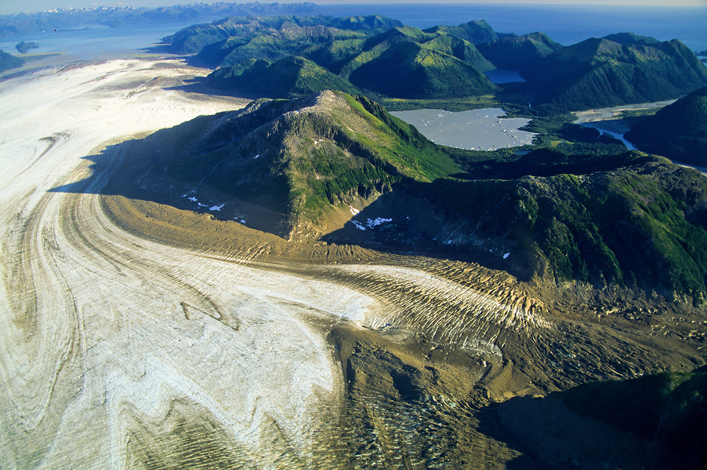 Alaska. Glacier Bay NP. Ice flows from high coastal mountains to the sea. Brady Icefield.