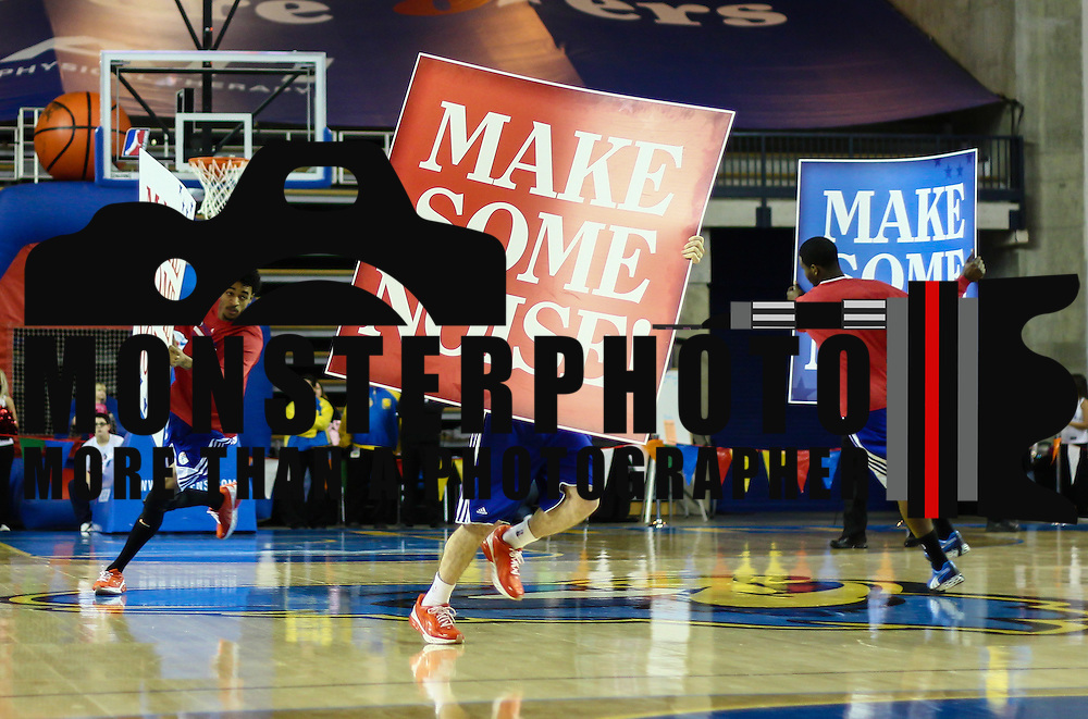 "Members of the Philadelphia 76ers flight squad performs with signs that reads ""Make Some Noise"" during a routine timeout in the first half of a NBA D-league regular season basketball game between the Delaware 87ers (76ers) and the Iowa Energy Tuesday, Jan 14, 2014 at The Bob Carpenter Sports Convocation Center, Newark, DE"