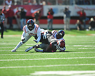Ole Miss linebacker Mike Marry (52) tackles Arkansas wide receiver Julian Horton (2)  at War Memorial Stadium in Little Rock, Ark. on Saturday, October 27, 2012. Ole Miss won 30-27...