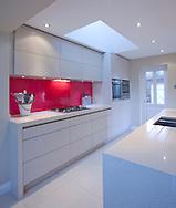 kitchen. white units. red splashback. Kitchen interiors
