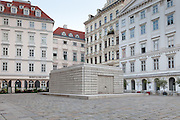 """The Judenplatz Holocaust Memorial also known as the Nameless Library stands in Judenplatz in the first district of Vienna, Austria. It is the central memorial for the Austrian victims of the Holocaust and was designed by the British artist Rachel Whiteread. Unveiled on 25 October 2000, Inscriptions below the doors read """"In commemoration of more than 65,000 Austrian Jews.who were killed by the Nazis between 1938 and 1945."""""""