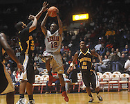 """Ole Miss guard Chris Warren (12) drives to the basket past Southern Mississippi guard R.L. Horton (15) at C.M. """"Tad"""" Smith Coliseum in Oxford, Miss. on Saturday, December 4, 2010."""