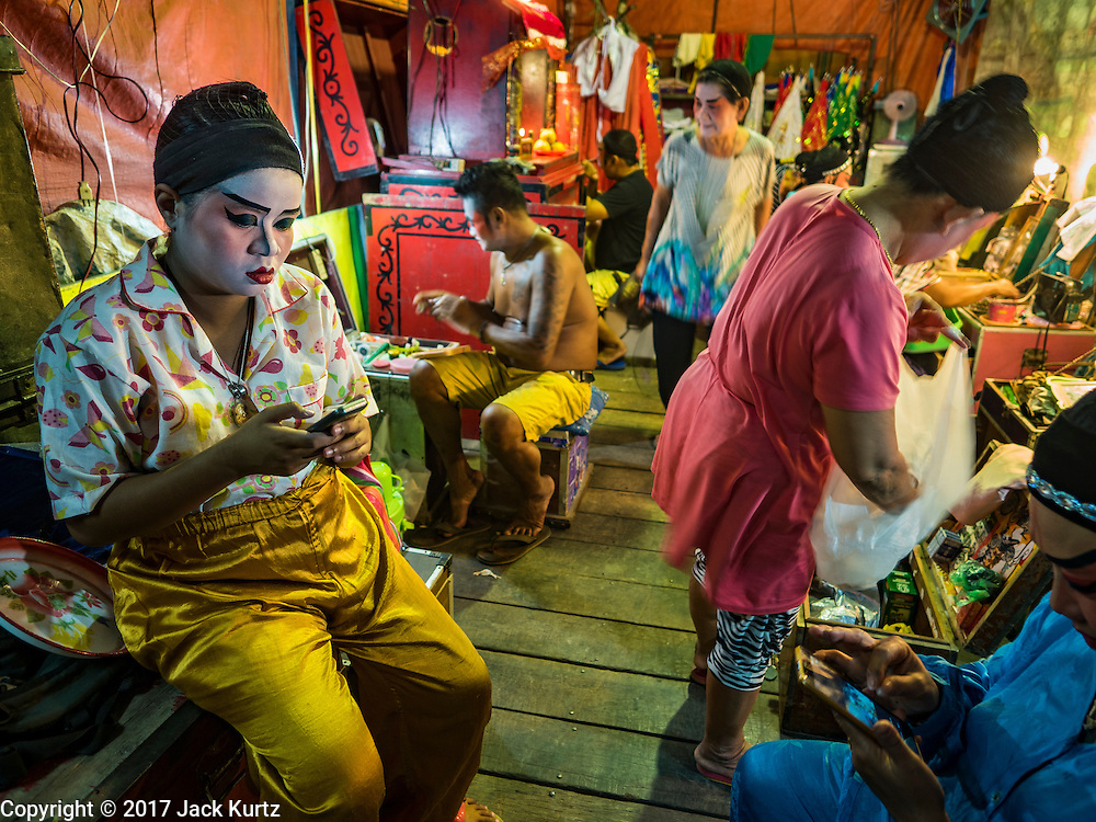 04 FEBRUARY 2017 - BANGKOK, THAILAND: Backstage at a Chinese opera performing for the Lunar New Year at the Phek Leng Keng Shrine in the Khlong Toey section of Bangkok. Many Chinese shrines and temples host Chinese operas during the Lunar New Year. Lunar New Year was January 28 this year and opera troupes are finishing their holiday engagements at the local temples.     PHOTO BY JACK KURTZ