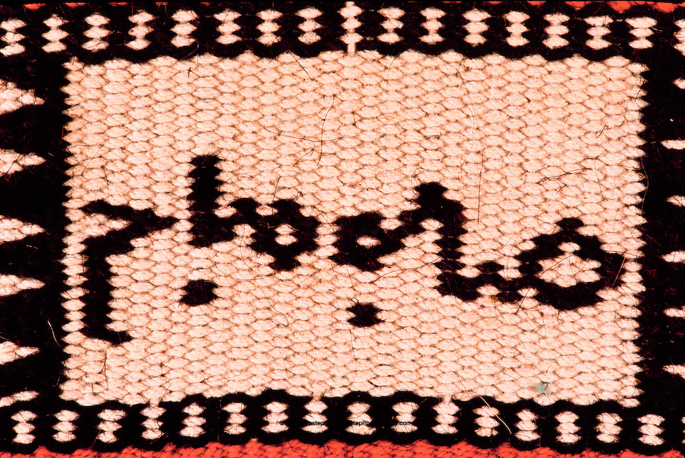 Tent dividing wall, Ruwag, woven of black goat hair. It is a good morning greeting woven by an Al Amrah Bedouin lady. Dahana Sands, Saudi Arabia