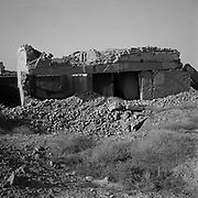 A view of one of many residential buildings destroyed by U.S. bombs at Tarnak Farms, the al Qaeda base, training camp and pre 9/11 al Qaeda headquarters in Kandahar, Afghanistan which served as a home to Osama Bin Laden and numerous al Qaeda fighters located outside Kandahar City. It is believed that this base was where the plan for the 9/11 attacks originated, as a result Tarnak Farms was heavily bombed by the United States after September 11, 2001. (Credit Image: © Louie Palu/ZUMA Press).