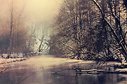 Winter sun on the misty waters of river Wupper. Textured photo.<br />
