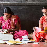 CAPTION: Every self-help group (SHG) has various office-bearing positions, including chairperson (right) and treasurer (left). LOCATION: Doddarayapete (village), Kasaba (hobli), Chamrajnagar (district), Karnataka (state), India. INDIVIDUAL(S) PHOTOGRAPHED: Left: Suvarna; right: Shobha.