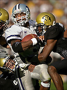 SHOT 10/5/2002 - A trio of University of Colorado defenders try to haul down Kansas State quarterback Ell Roberson (#3) during the second half of their game at Folsom Field Saturday in Boulder, CO. Colorado won the game 35-31. Roberson made a number of big plays running the ball on the option including a long touchdown run in the game.
