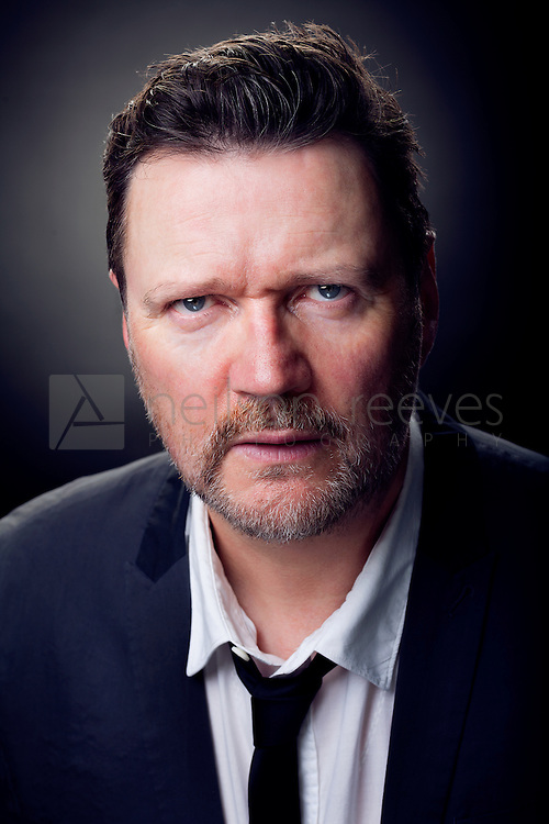 In this portrait Ian demonstrates his acting abilities and shows lots of emotion to the camera. The shirt undone with tie loose adds to the mood of a broken man who could have lost everything at the casino