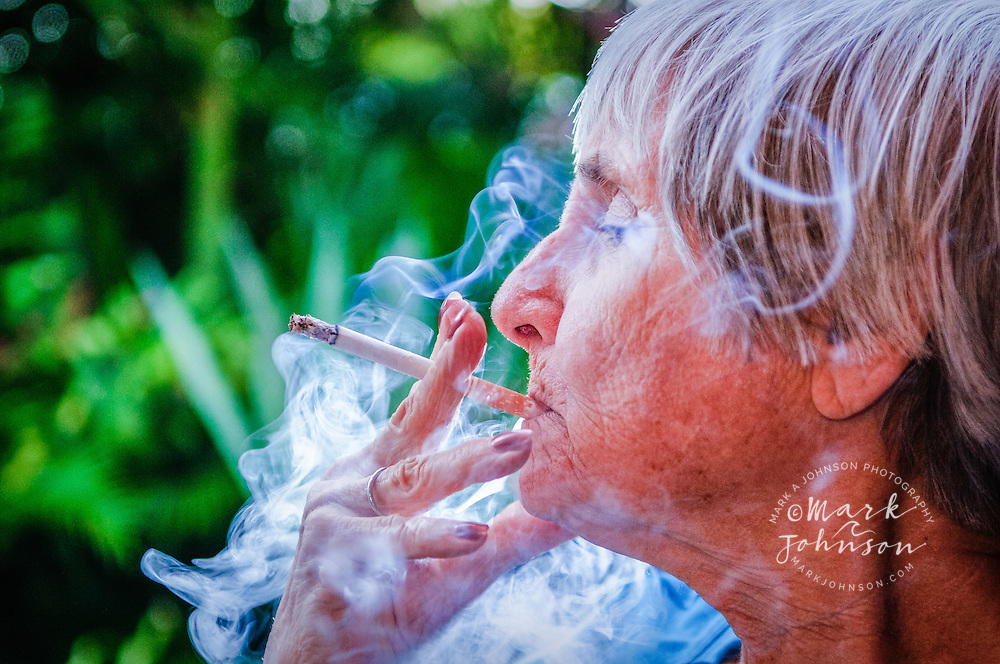 Brisbane, Australia --- Mature woman smoking cigarette, Brisbane, Queensland, Australia