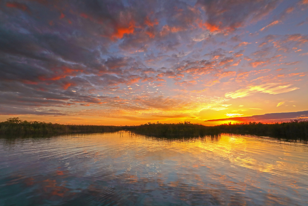 South Florida nature photography from outdoor photographer Juergen Roth showing a stunning sunset across Loxahatchee National Wildlife Refuge located west of Boynton Beach in Palm Beach County, FL. Arthur R. Marshall Loxahatchee National Wildlife Refuge is an amazing area for viewing wildlife and photography in Florida. <br /> <br /> Sunset art photos of the Arthur R. Marshall Loxahatchee National Wildlife Refuge area are available as museum quality photo prints, canvas prints, wood prints, acrylic prints or metal prints. Fine art prints may be framed and matted to the individual liking and decorating needs:<br /> <br /> http://juergen-roth.pixels.com/featured/sunset-at-loxahatchee-national-wildlife-refuge-near-florida-boyton-beach-juergen-roth.html<br /> <br /> All digital nature photo images are available for photography image licensing at www.RothGalleries.com. Please contact me direct with any questions or request.<br /> <br /> Good light and happy photo making!<br /> <br /> My best,<br /> <br /> Juergen<br /> Prints: http://www.rothgalleries.com<br /> Photo Blog: http://whereintheworldisjuergen.blogspot.com<br /> Instagram: https://www.instagram.com/rothgalleries<br /> Twitter: https://twitter.com/naturefineart<br /> Facebook: https://www.facebook.com/naturefineart