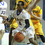 Delaware Guard Jarvis Threatt (4) drives to the basket in the first half of a regular season NCAA basketball game against George Mason Saturday, March 2, 2013 at the Bob Carpenter Center in Newark Delaware.