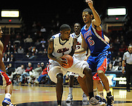 "Ole Miss' Terrance Henry (1) vs. SMU's London Giles (11) and SMU's Cannen Cunningham (15) at the C.M. ""Tad"" Smith Coliseum in Oxford, Miss. on Tuesday, January 3, 2012. Ole Miss won 50-48."