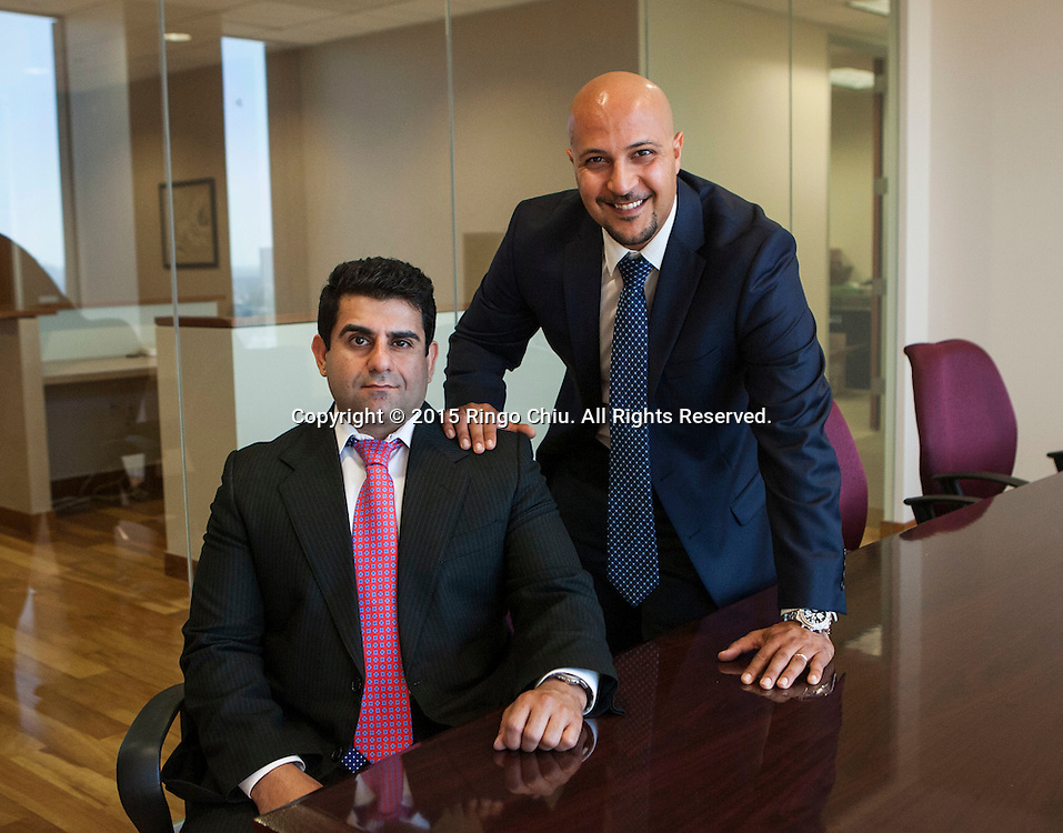 Anoush Hakimi, right, chief executive, and Peter Shahriari, COO of Trial Funder Inc. <br /> (Photo by Ringo Chiu/PHOTOFORMULA.com)
