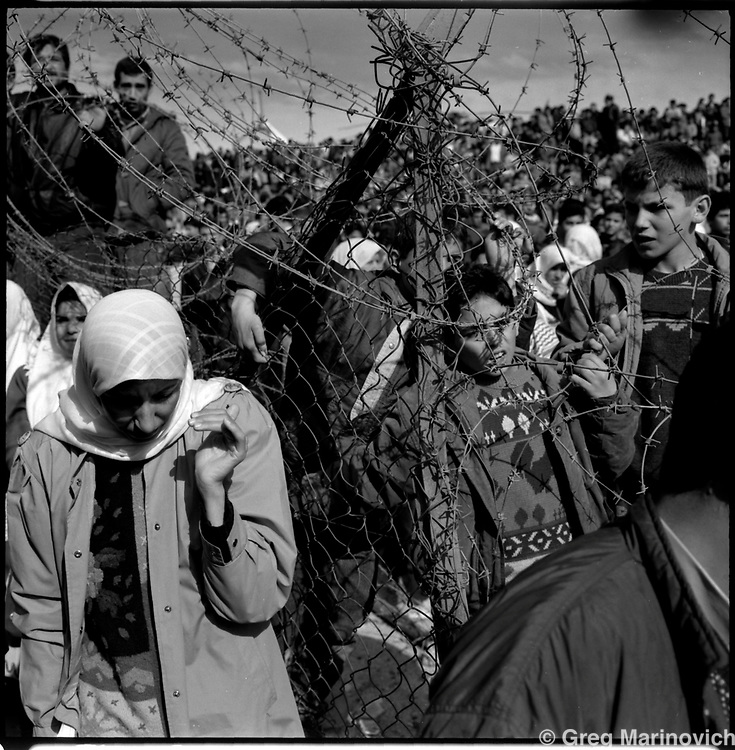 CONFLICT ISRAEL PALESTINE 1997: A crowd of Palestinians wait for the arrival of Yasser Arafat in the divided city of Hebron 1997. The city is revered as the burial place of the patriarch Abraham, and several hundred Jewish settlers live in Israeli controlled areas among the tens of thousands of Palestinians under Palestinian Authority control. From 'Scars' series. (Photo by Greg Marinovich / Getty Images)