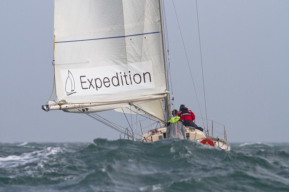 Expedition Coppelia sailed by Rob Croft and Sally Garrett drops behind a large wave at the Wellington restart of Round North Island two-handed yacht race. Wellington, New Zealand. 2 March 2011. Photo: Gareth Cooke/Subzero Images