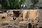 BOULDER, CO - SEPTEMBER 13: Local residents take in some of the damage along Topaz Street in Boulder, Colorado as heavy rains fueled widespread flooding in numerous Colorado towns on September 13, 2013. The street was washed away in large sections by Four Mile Canyon Creek which is normally a trickle at this time of year according to locals. (Photo by Marc Piscotty/ © 2013)