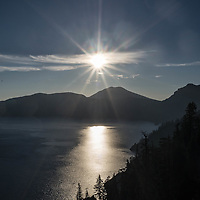 The morning sun shines brightly upon Crater Lake