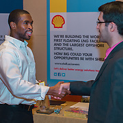 A representative from Shell's HR meets with career-seekers at the NACE BP Career Fair in San Antonio. Photography by Dallas event photographer William Morton of Morton Visuals event photography.